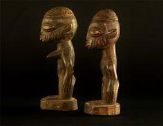 Item #994 Type of object: Yoruba Ibeji twins Ethnic group: Yoruba  Country of origin: Nigeria Measurement: Male 8.5 x 7.5 x 22 cm  Female: 9 x 9 x 22.5 cm  Materials: Wood Weight: Male 225 grams Female: 275 grams