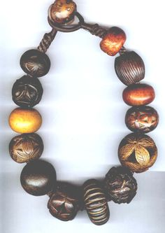 Linda Pastorino | A necklace made up of a collection of old carved Tibetan wood beads that would once have been used on tobacco pouches and pipe ends.  6-12-14