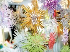 Paper Snowflakes. #sparkle #winter #crafts http://www.ivillage.com/fresh-diy-christmas-decorations/7-b-504702#505830