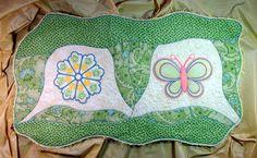 Schmetterling und Rosette