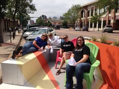 """Have you seen or visited the #parklet in front of Epicentral Coworking on N. Tejon? Installed by Colorado Springs Urban Intervention, the parklet is a reminder that """"the right-of-way and street are not only for the metal apparatus that we transport in, but for people."""" Last week some of our staff enjoyed the parklet during a team building exercise."""