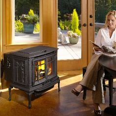 Avalon Arbor Pellet Stove: sculptured legs, picture frame fire viewing doors to the blooming cast iron cherry blossoms that entwine themselves up the sides. Available at Rich's.