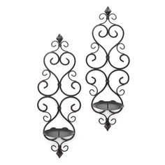 These dazzling iron candle sconces will dress up any wall with continental style and flair. Just add pillar candles, and the intricate scrolling metalwork desig