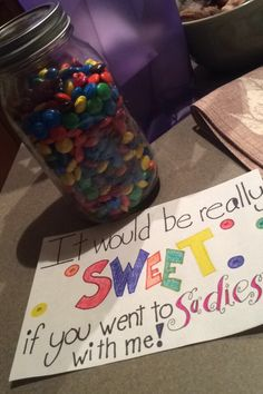 This is how I asked my boyfriend to the Sadie Hawkins dance. I put the note inside the jar of m&ms.