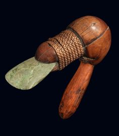 A rare and very fine Master-Carver's adze. The bulbous body is split horizontally to accommodate the serpentine blade and subsequently tightly wrapped with a braided fiber binding. New Caledonia, Melanesia, Oceania. 18th/19th century.