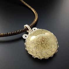 Embed a real dandelion clock in resin to make this amazing pendant!