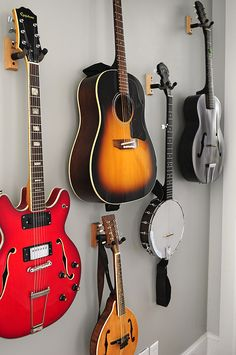 Guitar Wall - We need a functional and pleasant way of storing all our instruments. This could be good in Hub's office. Need wall mounts.