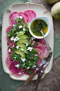 watermelon radish salad with avocado and arugula