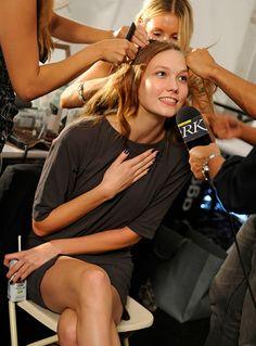 Karlie Kloss multitasking backstage before the DVF Spring 2010 runway show. See more on World of DVF: http://on.dvf.com/1KauiZh #FlashbackFriday