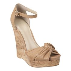 """As seen in the August issue of Essence Magazine.....peep toe cork wedge platform sandal with leather upper.  Cinched knotted front detail.  Adjustable ankle buckle closure.  Measurements: wedge 4 3/4"""" and 1 1/4"""" platform."""
