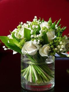 Wedding Bouquet Featuring: White Roses, White Lily Of The Valley, Green Viburnum & Green Foliage