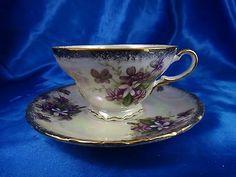 Vintage Porcelain Teacup And Saucer With Purple Floral Design