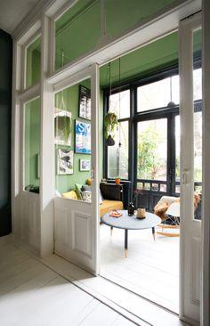 white pocket doors and green walls. / sfgirlbybay