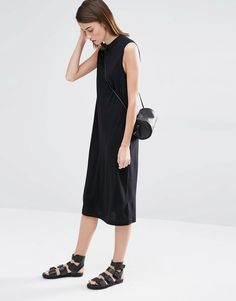 black sleeveless dress and cool sandals.  perfect summer outfit.