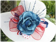 Wear this patriotic hat with the rose on either side or in the back