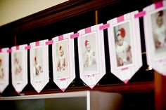 """Gorgeous """"Pretty in Pink"""" first birthday party - a month-by-month photo banner made with printables from Chickabug"""