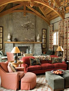 The Mediterranean-inspired family room is designed with rugged textures and comfy textiles. A vaulted wood-paneled ceiling crowns the room, while the furniture arrangement allows for two comfortable sitting areas.
