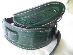 """Leathercraft Straps By Leathercraft - Made In U.K. Celtic Design Real Leather Guitar Strap - Green by Leathercraft. $31.36. WIDTH 2"""" LENGTH 54"""" THIS REAL LEATHER CELTIC DESIGN STRAP IS SUITABLE FOR MOST ACOUSTIC OR ELECTRIC GUITARS AND BASICALLY ANY STRINGED INSTRUMENT THAT IS MEANT TO HAVE A STRAP"""