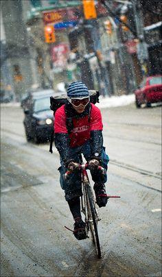 """Biker on Queen Street West"" Toronto photo by Sam Javanrouh"