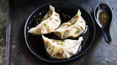 Pork and chive dumplings with red vinegar sauce