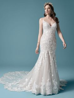 Giana| Floral lace mermaid wedding gown with scalloped train. #wedding #weddingdress #weddingdresses #bride #bridalgown #weddiingplanning #weddingfashion #maggiesottero
