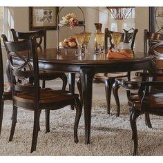 """Preston Ridge Round Dining Table by Hooker Furniture. $965.80. Physical Distressing. One matching 18"""" leaf extends table to 66"""" leaf.. 864-75-203 Features: -Crafted from hardwood solids with cherry, mahogany and white ash burl veneers.-One matching 18in. leaf extends table to 66in. leaf. Color/Finish: -Distinctive black rub-through finish with a rich contrasting cherry finish. Dimensions: -Overall dimensions: 30'' H x 48-66'' W x 44'' D."""