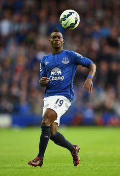 Christian Atsu Photos - Christian Atsu of Everton in action during the Barclays Premier League match between Everton and Arsenal at Goodison Park on August 2014 in Liverpool, England. - Everton v Arsenal Goodison Park, Barclay Premier League, Everton Fc, World Football, Premier League Matches, Arsenal, Liverpool, Christian, August 2014
