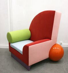 This model Bel Air chair was designed by Peter Shire and manufactured by Memphis Milano in Italy, 1982. The chair is made from multicolored cotton upholstery and a wooden frame. It is in a very good vintage condition, with four small scratches on the green armrest, fabric slightly discoloured.