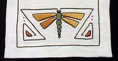 """Price: $50.00 Finished size: 11"""" x 42"""" Flax Canvas natural linen The body and wings are worked in satin stitch, other stitches used are stem stitch and French knots. In a choice of three color combinations^11"""" x 42"""" Flax Canvas Choice of: Gold/Olive Burgundy/Teal Blue/Green"""