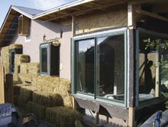 A run-down, energy inefficient house was wrapped in straw bales - great insulation and a slick new look on a small budget.