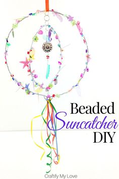Sparkly sequinned and beaded suncatcher hoop mobile to add a pop of colour to your garden. Click through for a detailed tutorial on how to make this wind spinner for little money. via decor diy thrift stores Beaded Suncatcher Mobile DIY Diy Craft Projects, Decor Crafts, Diy Crafts, Recycling Projects, Craft Ideas, Wind Spinners, Sun Catchers, Thrift Store Crafts, Thrift Stores