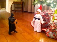 Elf on the Shelf Karate Kid. Getting ready to break Batman's Board. Black Belt. Taekwondo Elf.