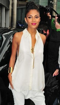 Nicole Scherzinger . love this look! topknot and white flowy top with skinny pants.