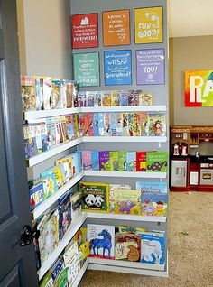I love the idea of a library corner in a kid's playroom - comfy pillows are a must. I like how you can see all of the books, but I'm thinking this might become an issue space-wise if you have a lot of books. Display Shelves, Shelving, Book Shelves, Library Shelves, Bookshelf Ideas, Simple Bookshelf, Corner Bookshelves, Open Bookcase, Ikea Shelves