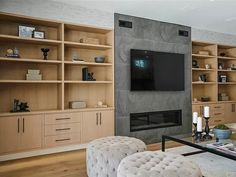 12818 Landale St, Studio City, CA 91604 | MLS #SR20094071 | Zillow Family Room, Home And Family, Wine Display, Pivot Doors, Black Appliances, Bar Seating, Stone Countertops, Studio City, Living Room With Fireplace