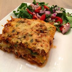 Lasagna!!!! Layers of grilled eggplant, minced meat, grated cheese, grilled zucchini, minced meat and grated cheese!! And a salad on the side.