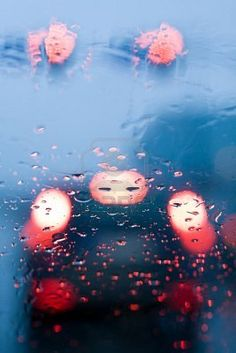 Traffic jam from inside a car during storm with rain drops on window. Shallow depth of field with focus on center of the windshield with red lights. Stock Photo To me, this looked like a mum holding two babies. Rain Dance, Dancing In The Rain, Rainy Night, Rainy Days, Rain Drops On Window, Smell Of Rain, Red Lights, Shallow Depth Of Field, Rain Photography