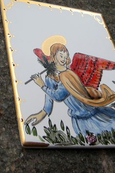 Hand painted tile with an angel. - Colour and Gold.