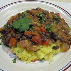 Cuban Black Beans.  You can make these in the slow cooker as well...always a selling point for me!  These look really yummy.
