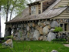 Stone Home - Love these boulders. Cottage fortress sort of feel. Very interesting and attractive!