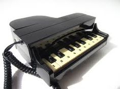 Omg! I bought my mother one of these in the 80s! Haven't seen it in forever! (piano keyboard telephone)