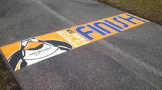 This is finish line was created by Trump Direct for a sports event.  By printing onto Asphalt Art, they were able to create a durable ground graphic and install it in next to no time.  www.asphaltartusa.com