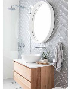 Coastal Home Interior Grey herringbone subway tile on modern bathroom with floating vanity, white vessel sink and round mirror Bad Inspiration, Bathroom Inspiration, Bathroom Inspo, Bathroom Subway Tiles, Modern Bathroom Vanities, Round Bathroom Mirror, Bathroom Sink Decor, Modern White Bathroom, Bohemian Bathroom