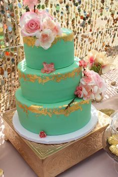 Such a gorgeous mint, coral and gold cake at this Baby Shower! See more party ideas at CatchMyParty