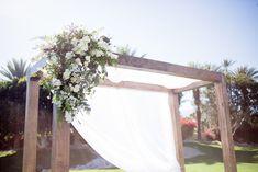 Arrangements Floral + Party Design — Rancho Mirage, Lauren + Chris | Whispy canopy floral arrangement, wedding ceremony, outdoor wedding, desert wedding Wedding Desert, Rancho Mirage, Outdoor Furniture, Outdoor Decor, Canopy, Floral Arrangements, Wedding Ceremony, Wreaths, Party