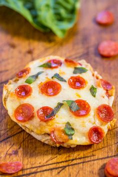 Easy Mini Pepperoni Pizzas - Ready in 10 minutes, mindlessly easy, and mini food just tastes better!! Great as an appetizer, after-school or late-night snack, or as perfect tailgating party food!!