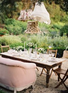French Garden Party - rustic outdoor dining area with a French farmhouse table and shabby chic hanging light fixtures - via A Fanciful Twist Outdoor Rooms, Outdoor Dining, Outdoor Gardens, Outdoor Seating, Outdoor Sofa, Reception Seating, Garden Seating, Vintage Outdoor Decor, Vintage Tea Parties