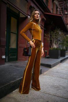 New York fashion blogger Mary Orton of Memorandum wears cut out long sleeve turtleneck by ALC, Veronica Beard velvet gold tuxedo wide leg trousers, Tory Burch multi jewel toned handbag and Amber Sceats sculptural gold earrings