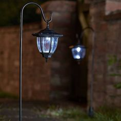 Perfect for illuminating paths and borders, this 2 pack of rustic coach lanterns are solar powered and automatically light up at night. Designed in a stylish br. Small Garden Lanterns, Solar Garden Lamps, Garden Lamp Post, Outdoor Solar Lanterns, Solar Lantern Lights, Lanterns Decor, Light Decorations, Solar Led, Solar Panels