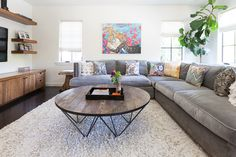 The family already owned this gray sofa. Originally, they had wanted to replace it with something more colorful but in consideration of the budget, Michael decided to dress it up with some colorful patterned pillows instead.